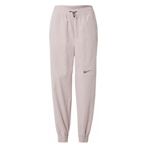 Nike Sportswear Nohavice  púdrová