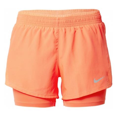 NIKE Športové nohavice  koralová