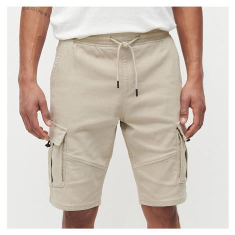 Reserved - Joggerové šortky s cargo vreckami - Béžová