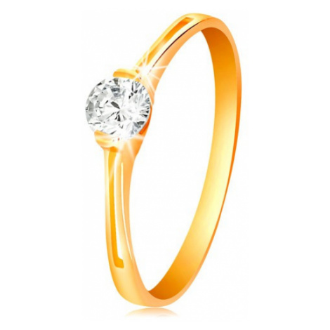 Prsteň v žltom zlate 585 - žiarivý číry zirkón v lesklom kotlíku, výrezy - Veľkosť: 60 mm