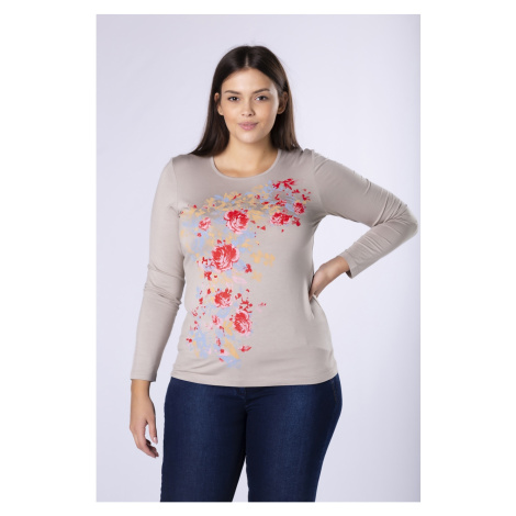 fitted blouse with a floral print on the front