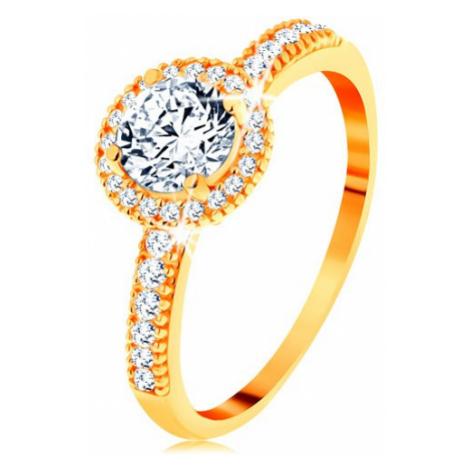 Prsteň zo žltého 14K zlata - zirkón čírej farby lemovaný drobnými zirkónikmi - Veľkosť: 65 mm