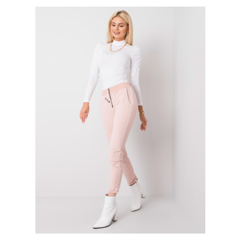 Dusty pink sweatpants with a zip