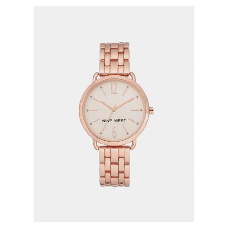 Dámske hodinky s kovovým remienkom v ružovozlatej farbe Nine West