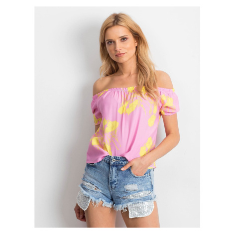 Spanish pink blouse with a floral motif
