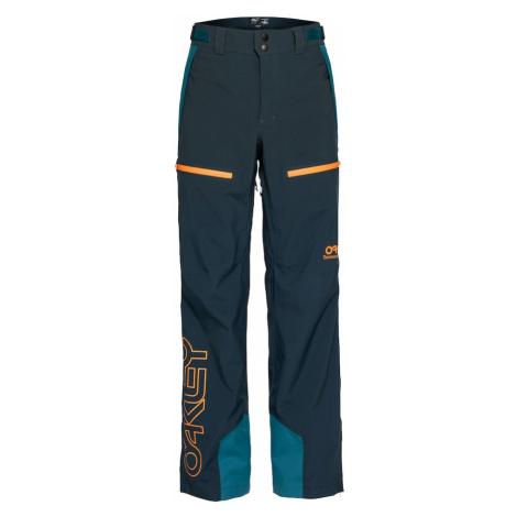 OAKLEY Outdoorové nohavice  tmavomodrá / oranžová / nefritová
